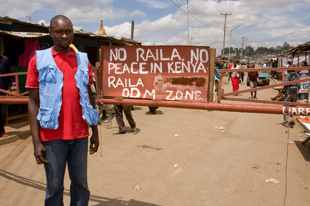 A volunteer stands at a gate he guarded during the ethnic violence after Kenya's elections 2007.