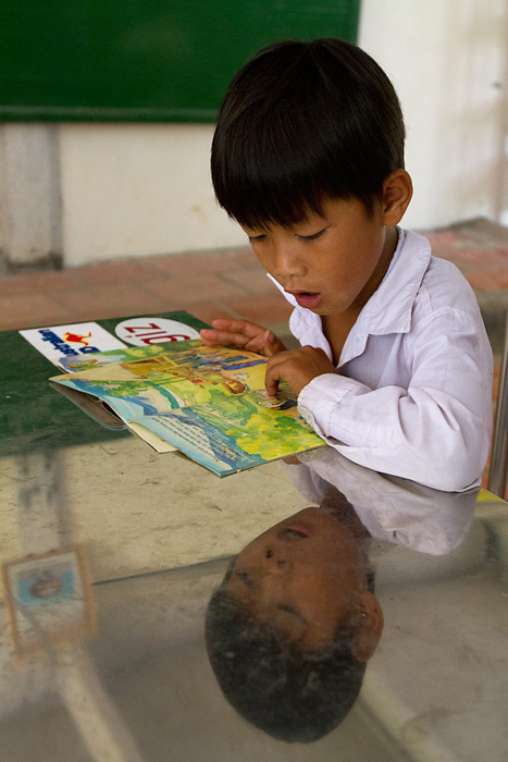 A young boy learns about environmental protection in a school in the Mekong Delta