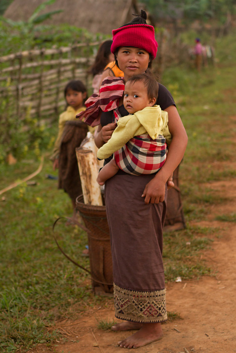 Young mother with child in rural Attapeu province, Laos.