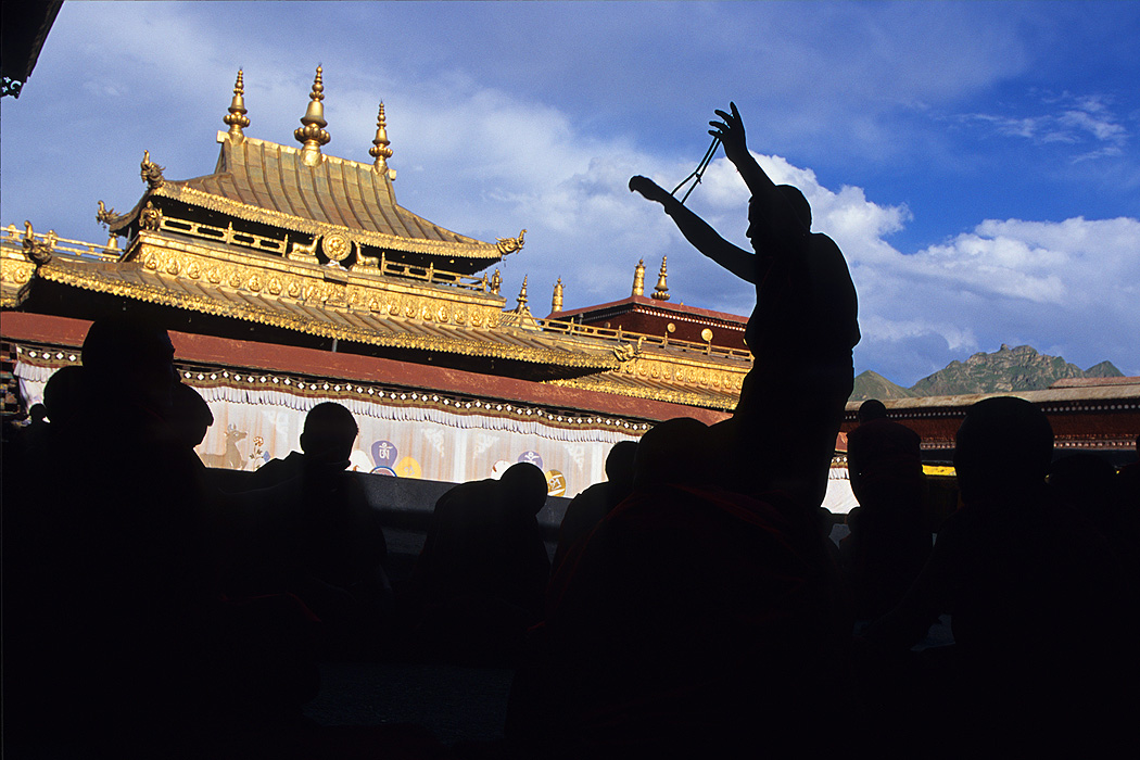 A monk teaches on the roof of the monastery