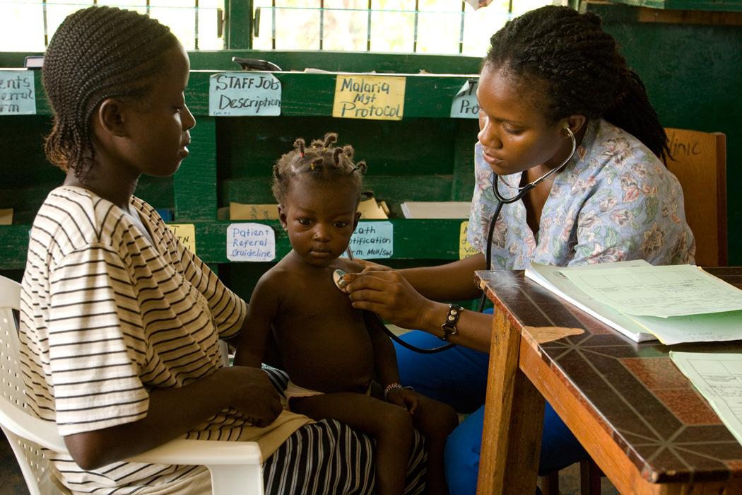A local UN Volunteer nurse examines a patient in Grand Bassa County, Liberia.