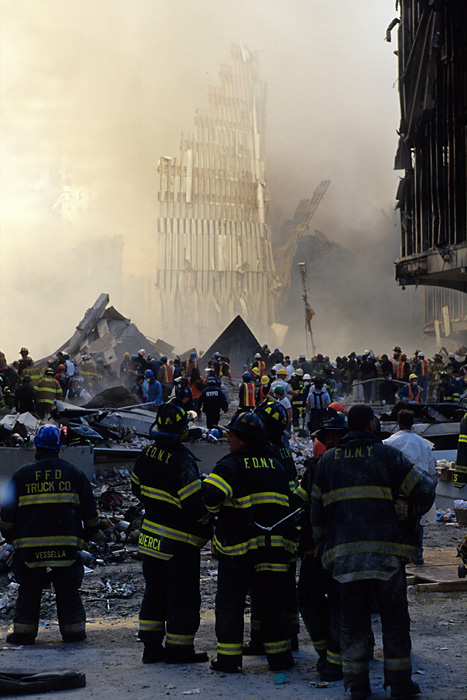 Firefighters stare at the remains of One World Trade Center