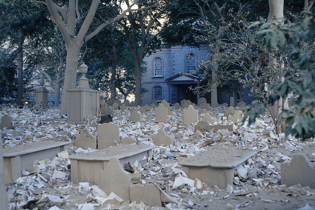 Debris covers the cemetery of St. Paul's Chapel, the oldest church in Manhattan, located just across Church Street from the WTC