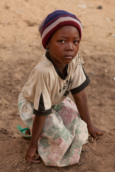 An orphan girl outside an orphanage in N'Djamena, Chad