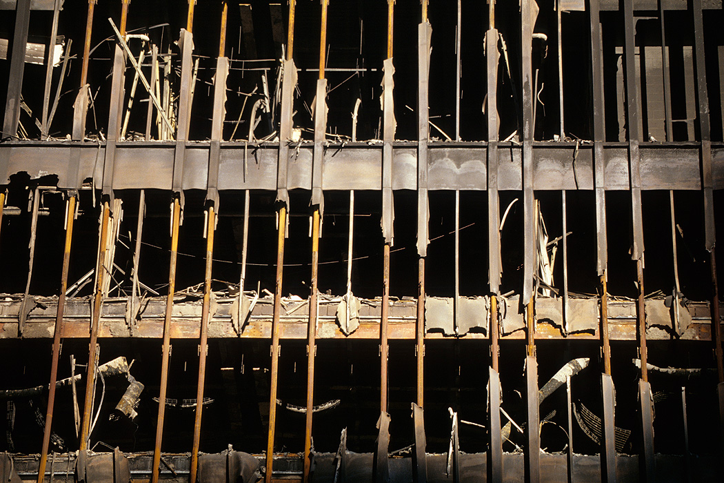The destroyed façade of World Trade Center 5, one of the low buildings east of the Twin Towers.