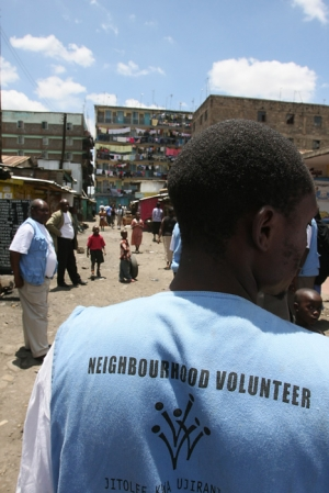 A neighborhood volunteer walks through Mathare Slum in Nairobi, Kenya.