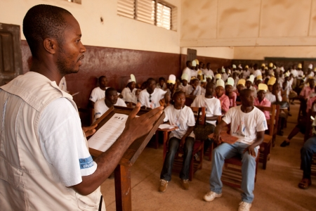 UN Volunteer Roosevelt Zayzay addresses students at Bassa Demonstration School in Liberia