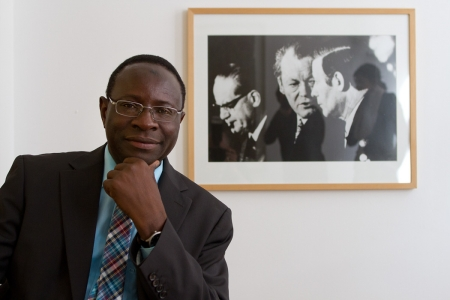 Karamba Diaby, the first African-born German MP poses with the most prominent post-war leaders of his party