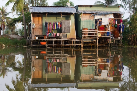 Homes along a canal in Kien Giang province, Vietnam