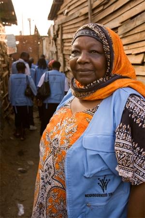 A neighborhood volunteer walks through Kibera Slum in Nairobi, Kenya.