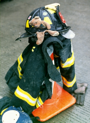 A firefighter has put down his gear near Ground Zero.