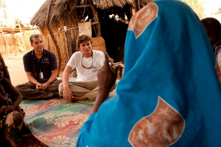 Two UN Volunteers speak to residents of the Djabal Refugee Camp in Goz Beida, Chad.