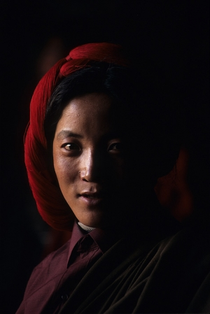 A Tibetan pilgrim wearing traditional headgear