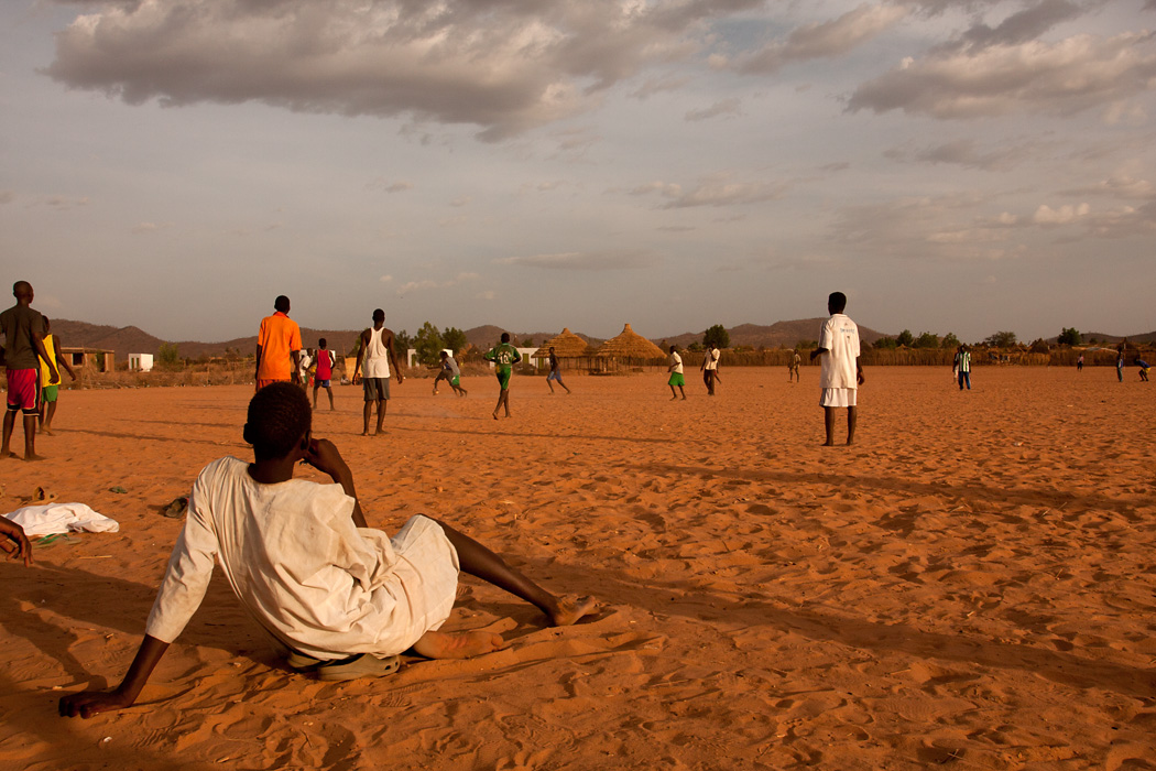 Young men play soccer at a refugee camp near Goz Beïda, Chad.